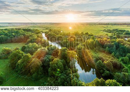 Landscape View From Above. The Countryside With A Meadows, A Groves And A Winding River Next To A To