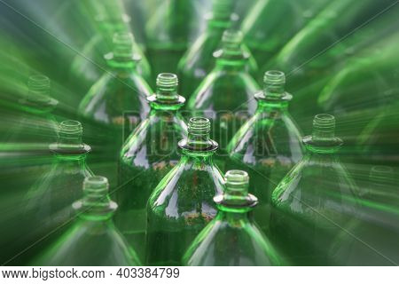 Many used green bottles with radial blur