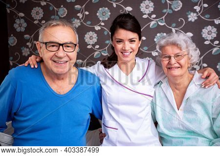 Senior Occupants In Company Of Their Loving And Diligent Caretaking Nurse, Senior People Facility Co