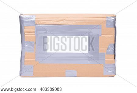 Package With Black Adress Sticker, Grey Duct Tape, Isolated