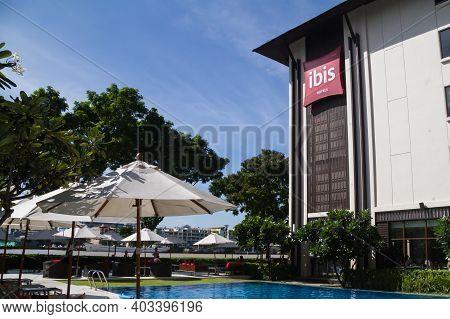 Bangkok, Thailand June 17 2017: Ibis Bangkok Riverside Hotel Outside View Of Sign And Swimming Pool.
