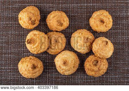 Few Coconut Cookies On Dark Mat. Top View