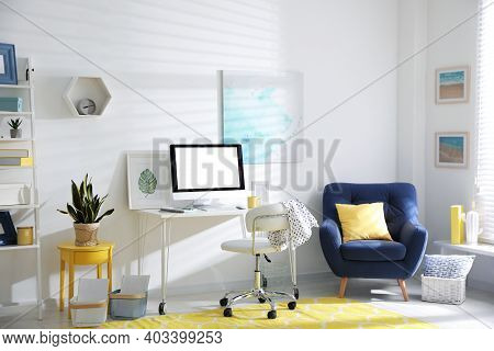 Comfortable Office Chair Near Desk With Modern Computer Indoors