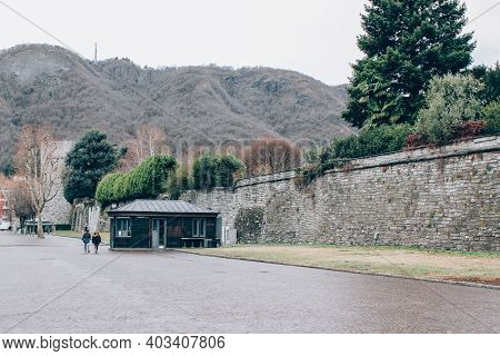 Como, Lombardy Region, Italy - January 14, 2021 : Medieval Walls, Walking Ancient Streets Cityview W
