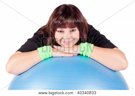 Shot Of A Overweight Young Woman Exercise On Fitness Ball Against White Background.