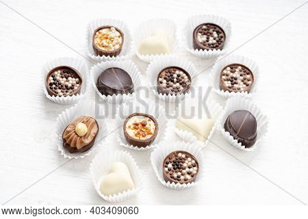 Different Chocolate Pralines. Belgian Pralines Of Different Shapes In Paper Baskets. Assortment Of F