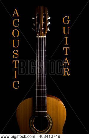 Acoustic Guitar. Musical Instrument. Spanish Guitar. Acoustic Guitar On A Black Background.