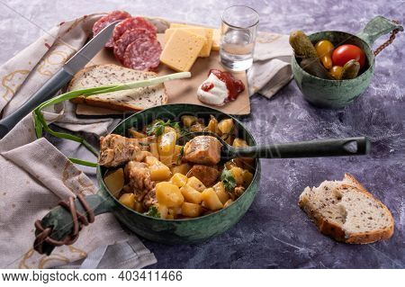 Serving Potatoes With Meat And Vodka. Potatoes With Meat And A Glass Of Vodka.