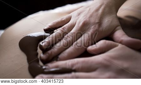 Spa Treatments At The Wellness Beauty Salon. Action. Close Up Of Back Massage With Moisturizing Coff