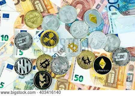 Various Cryptocurrency Coins On Euros. Bitcoin, Ethereum, Litecoin And Others Modern Virtual Currenc