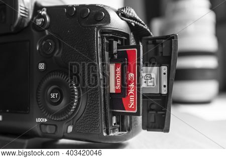 Uk - February 08, 2019. Sandisk Sd And Compact Flash Cf Memory Cards In A Canon Camera Slot. Sandisk