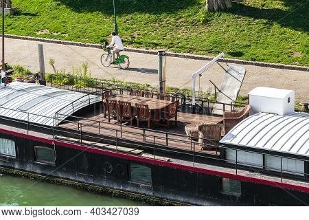 Paris, France - August 30, 2019: This Is A Living Fragment Of A Residential Barge Moored On The Sain