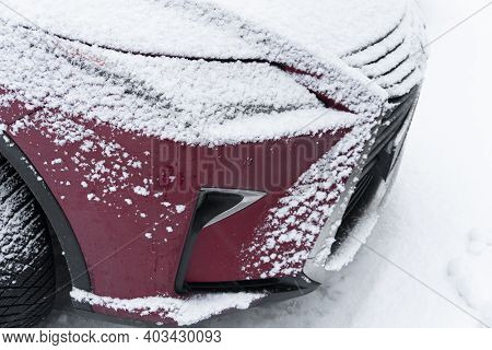 Frozen Car. Car Covered With Snow And Frost. Part Of The Car Under Snow After A Heavy Snowfall. The
