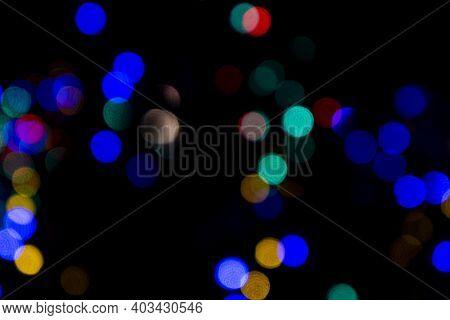 Bokeh With Multi Colors Dots. Festive Lights Bokeh Background. Defocused Bokeh Lights. Blurred Bokeh