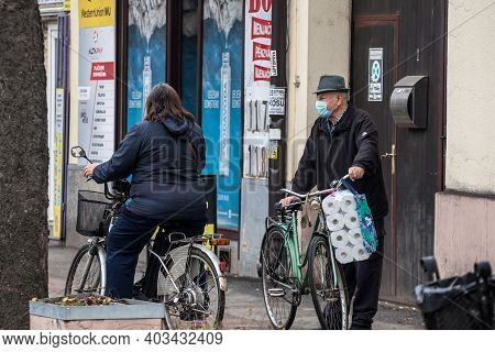 Subotica, Serbia - November 18, 2020: Old Senior Man Wearing A Respiratory Face Mask Discussing Hold