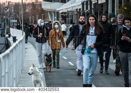 Belgrade, Serbia - December 12, 2020: Group Of Young Women, Friends, Drinking Coffee To Take Away Wa