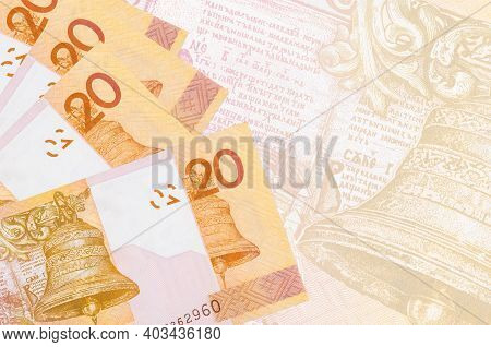 20 Belorussian Rubles Bills Lies In Stack On Background Of Big Semi-transparent Banknote. Abstract B