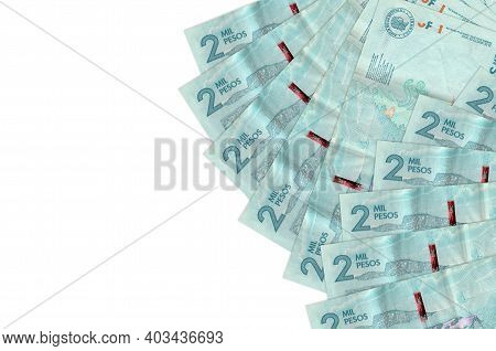 2 Colombian Pesos Bills Lies Isolated On White Background With Copy Space. Rich Life Conceptual Back