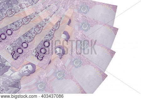 500 Thai Baht Bills Lies Isolated On White Background With Copy Space Stacked In Fan Shape Close Up.