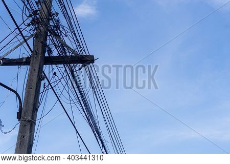 Close Up Old Electricity Poles With Telephone Lines Many. Under Sky Background.electric And Telephon