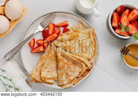 Thin Crepes Pancakes With Cream Cheese, Fresh Strawberry And Ingredients For Making Breakfast. Top V