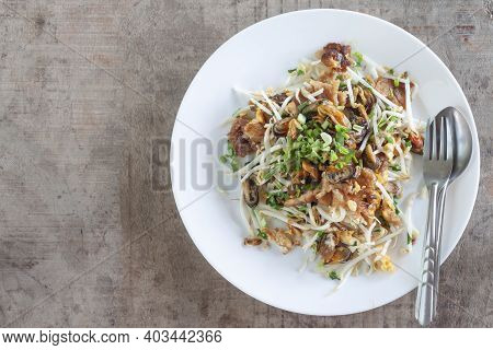 Crisp Fried Mussel Pancakes Or Mussel Omelette In White Plate With Fork And Spoon On Wooden Table Ba