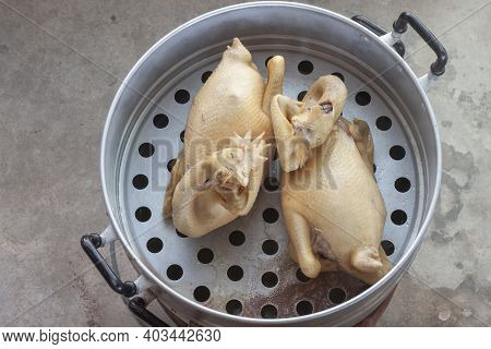 Steamed Chicken In Aluminium Steamer Or Steaming Pot On Stove.