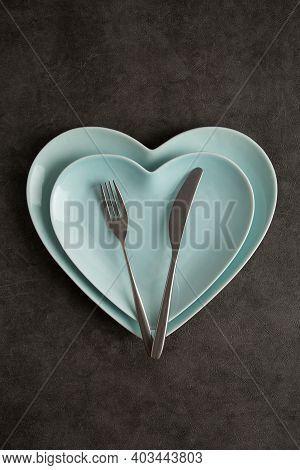 Heart Shape Light Blue Plates With Silverware At Gray Background