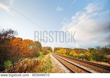 Railraod Tracks In The Fall On A Bright Day On Colorful Surroundings In Autumn