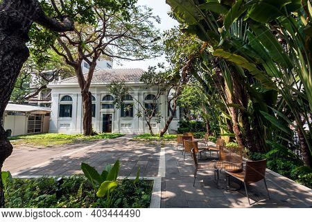 Bangkok, Thailand: Historical Neilson Hays Library With Tropical Garden Trees In Courtyard On Januar