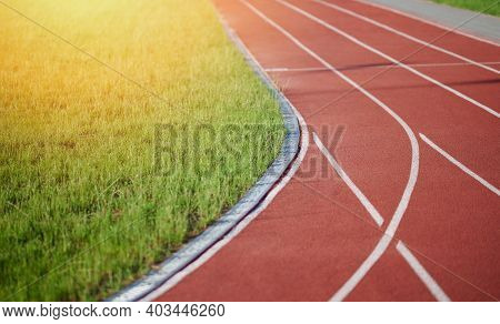 Turn On Running Sprint Arena With Grass On Sunny Day