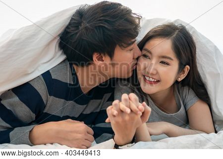Wonderful Young Couple Hug And Kissing And Enjoy Life Together And Smiling Tender Couple Hugging In