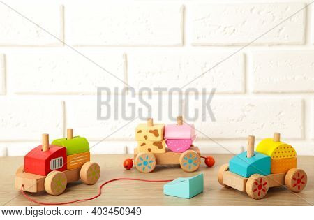Stacking Train Toddler Toy For Little Children On Light Background With Shadow Reflection. Baby Trai