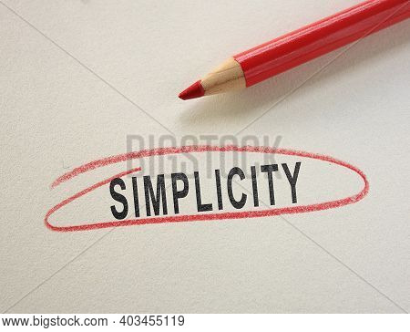 Simplicity Text Circled In Red Pencil On Paper