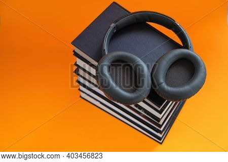 Audiobooks.reading. Training And Knowledge. Distance Education. A Stack Of Books And Headphones On A