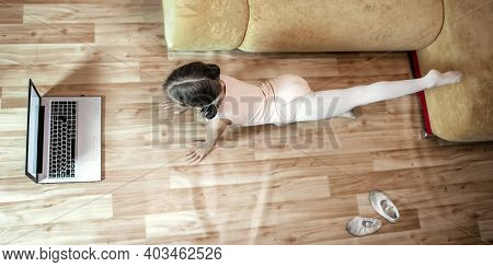 Online Hobby, Fitness, Distant Training. Young Ballerina Practicing Classic Choreography During Onli