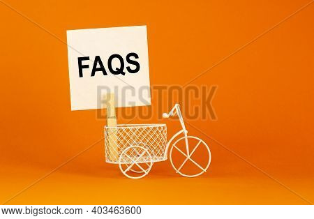 Faqs, Frequently Asked Questions Symbol. White Paper. Words 'faqs, Frequently Asked Questions'. Mini