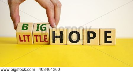 Little Or Big Hope Symbol. Hand Turns Wooden Cubes And Changes Words 'little Hope' To 'big Hope'. Be
