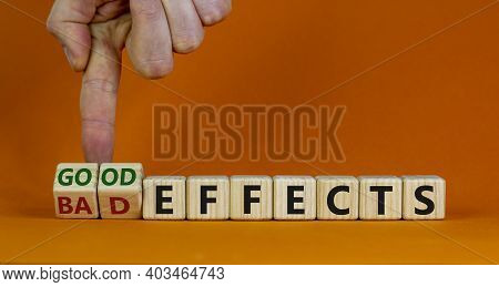 Bad Or Good Effects Symbol. Businessman Turns Wooden Cubes And Changes Words 'bad Effects' To 'good