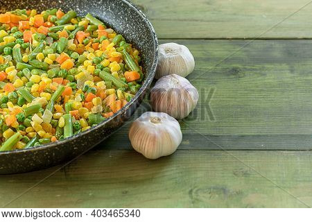 Mix On Vegetables Fried In The Wok On Wooden Background. Copy Space. Healthy Food Concept.