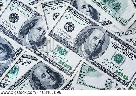 Background Of 100 Dollar Bills. Texture Us Dollars. Concept Of Money, Earnings, Wealth And Banking