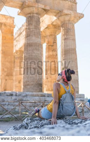 Woman Contemplating A Temple Of Paestum, Italy.