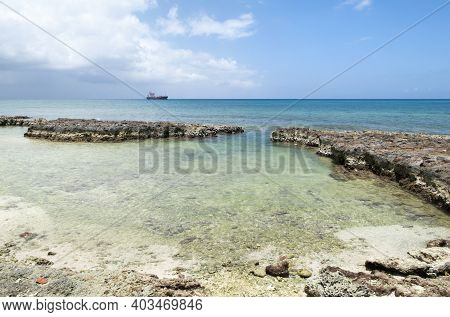 The Rocky Landscape And Crystal Clear Waters On Grand Cayman Island Seven Mile Beach (cayman Islands