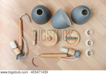Assembling Furniture At Home. Self-assembly Of The Chandelier. Details Of The Luster Laid Out On The