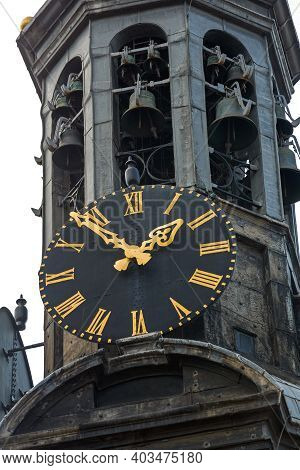 Black Dial Clock With Golden Needles At Church Spire In Amsterdam