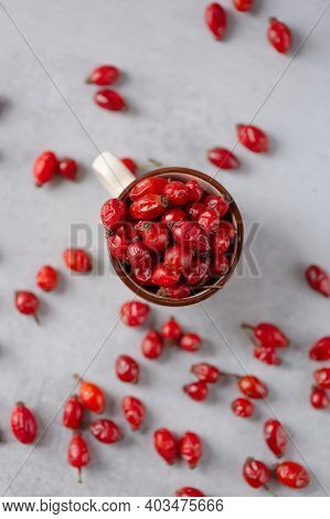 Composition Of Dog Rose On A Grey Stone Background