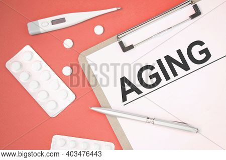 Notebook Page With Text Aging On A Table With A Pills And Pencil, Medical Concept, Top View