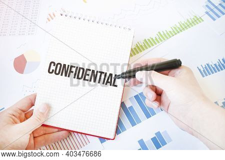 Notepad With Text Confidential. Diagram And White Background