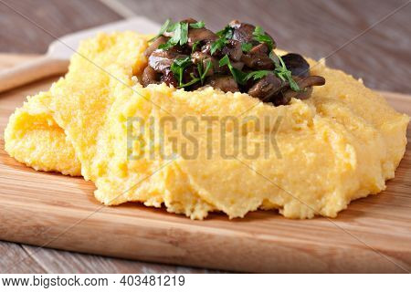 Polenta With Mushroom. Traditional Corn Food In The Plate.