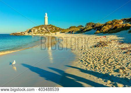 Rottnest Island, Western Australia - Jan 4, 2018: People On Pinky Beach And Bathurst Lighthouse Refl